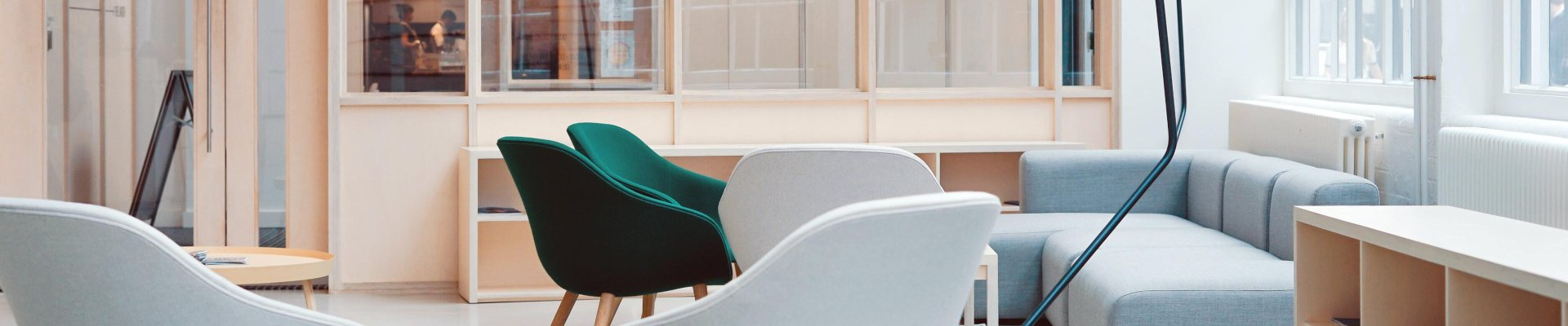 Coworking space with green and gray chairs