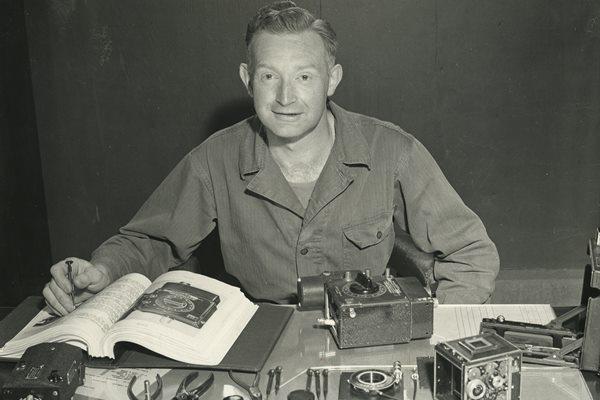 Adolph Gasser sitting at a desk